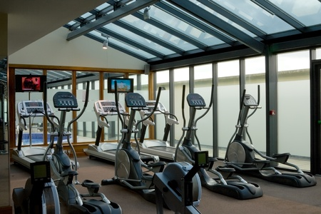 gym interior with equipment and row of jogging simulators Stock Photo