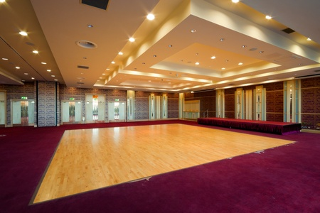 hall: Huge Hall interior with red carpet and ceiling with lights in Hotel