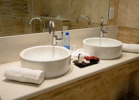 bathroom tile: Modern Bathroom interior, marble sink and tap