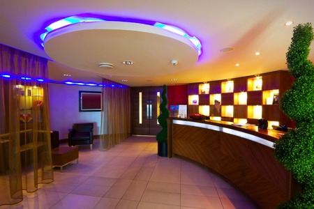 SPA reception interior with desk and multicolored lighting in Hotel