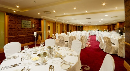 dinner hall: Hotel Hall interior with round tables set up for dinner