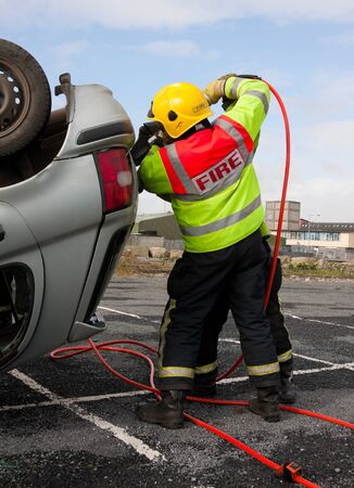 Fire and Rescue Imergency Units at car accident with Power Wedge photo