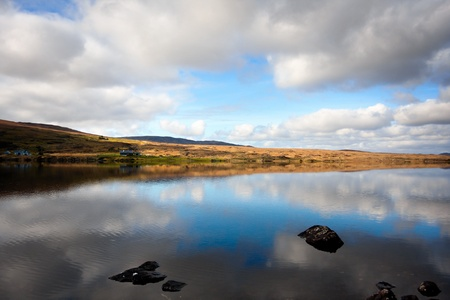 connemara: Buitiful Landscape with mountains and sky reflected in lake, Connemara, Ireland Stock Photo
