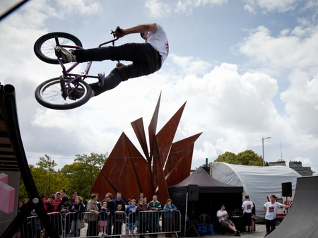 topsyturvy: GALWAY - JUNE 18: Bmx biker performing in the Galway Bike Festival on June 18, 2011 in Galway, Ireland.