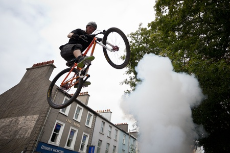 topsyturvy: GALWAY - JUNE 19: Bmx biker performing in the Galway Bike Festival on June 19, 2011 in Galway, Ireland.
