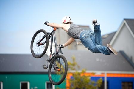 topsyturvy: GALWAY - JUNE 19: Bmx biker performing in the Galway Bike Festival on June 19, 2011 in Galway, Ireland.