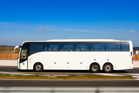 coach bus: Passenger bus in motion on motorway and blurred background