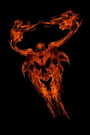 demonic: Monster scary Face Fire flame  silhouette isolated on black Stock Photo