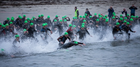 GALWAY - SEPTEMBER 4: Athletes start at first Edition of Galway Iron Man Triathlon on September 4, 2011 in Galway, Ireland