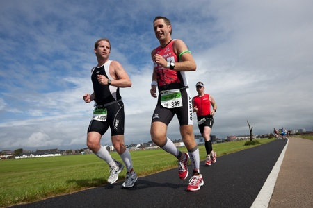 GALWAY - SEPTEMBER 4: John Cullinan (399) and Gavin Mcallister (1439) compete at first Edition of Iron Man  Triathlon on September 4, 2011 in Galway, Ireland