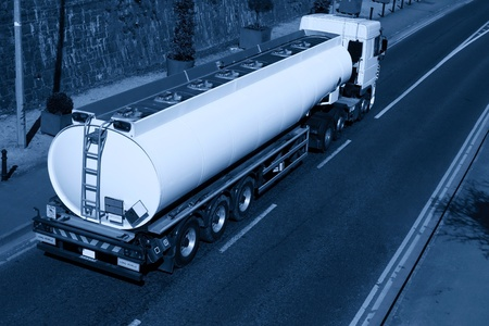 Truck With Fuel Tank in motion on the road photo