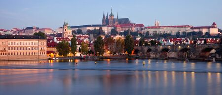 View of The Charles Bridge, Vltava river  and Prague Castle, sunrise photo