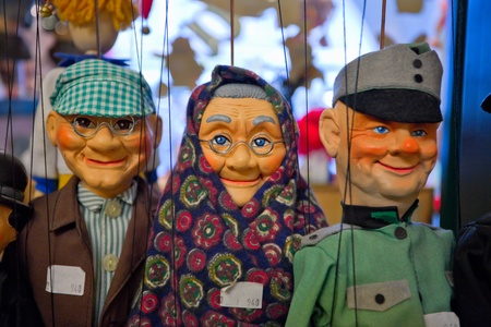 puppets with strings on display in the shop, Prague, photo