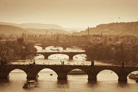 View at The Charles Bridge  and Vltava river in Prague, autumn photo