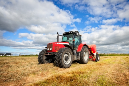 huge tractor collecting haystack in the field, panning technique Stock Photo - 10985844