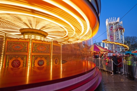 merry-go-round in motion at Christmas market in Galway, Ireland photo