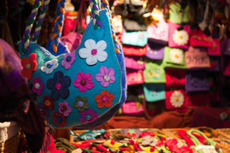 Handmade felt bags and flowers decorations at the market Stock Photo