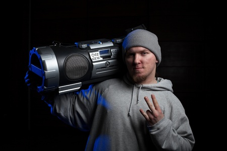 Young man, a dancer, posing with vintage boombox photo