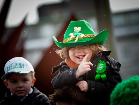 GALWAY, IRELAND - MARCH 17: Unidentified Kids enjoy watching the annual traditional St. Patrick  Day Parade on March 17, 2012