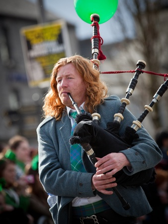 GALWAY, IRELAND - MARCH 17: Unidentified  Bagpipes musician performs at the annual St. Patrick Day Parade on March 17, 2012
