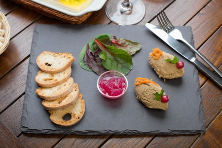 Home made Chicken Liver Pate, Onion Marmalade on the stone plate photo
