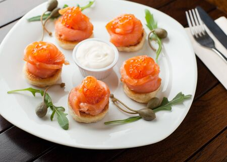 Salmon and Red Caviar on the pancake, shallow DOF photo