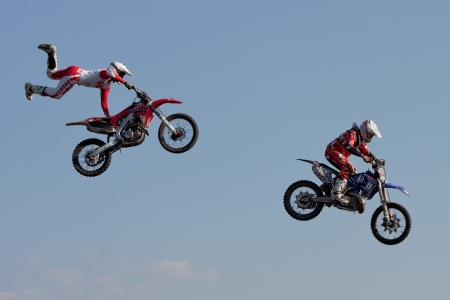 GALWAY, IRELAND - MAY 26:  J. Grindrod and D. Wiggins freestyle motocross riders jumps through the air during The  Extreme Stunt Show on May 26, 2012 in Galway, Ireland