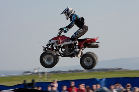 GALWAY, IRELAND - MAY 26:  Unidentified quadrocycle rider jumps through the air during The  Extreme Stunt Show on May 26, 2012 in Galway, Ireland