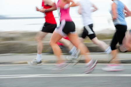 group of runners compete in the race, blurred motion