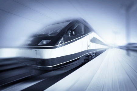 High-speed modern intercity train with motion blur, abstract Editorial