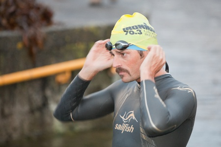 GALWAY, IRELAND - SEPTEMBER 2: Pro athlete Mike Aigroz (1), prepare to start at the Course – Swim during 2nd Edition of the annual Ironman 70.3 Galway 2012 Triathlon,on September 2, 2012 in Galway, Ireland.