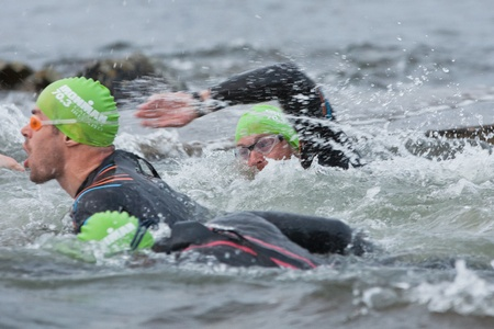 september 2: GALWAY, IRELAND - SEPTEMBER 2: Unidentified athletes  compete at the Course � Swim during 2nd Edition of the annual Ironman 70.3 Galway 2012 Triathlon,on September 2, 2012 in Galway, Ireland.