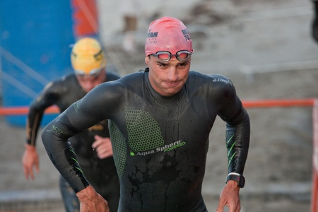 GALWAY, IRELAND - SEPTEMBER 2: Pro athlete Terenzo Bozzone (14), 2nd place, competing at the Course – Swim during 2nd Edition of the annual Ironman 70.3 Galway 2012 Triathlon,on September 2, 2012 in Galway, Ireland.