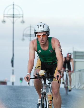 september 2: GALWAY, IRELAND - SEPTEMBER 2: Athlete Jack Bottomley (146) compete at the Course � Bike during 2nd Edition of the annual Ironman 70.3 Galway 2012 Triathlon,on September 2, 2012 in Galway, Ireland.