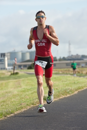 GALWAY, IRELAND - SEPTEMBER 2: Athlete  Harry Springall (98), Winner in category Male 18-24, competing at the Course � Run, during 2nd Edition of the annual Ironman 70.3 Galway 2012 Triathlon,on September 2, 2012 in Galway, Ireland.
