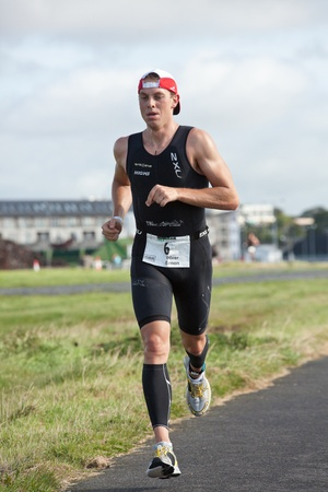 september 2: GALWAY, IRELAND - SEPTEMBER 2: Pro athlete Oliver Simon (6) competing at the Course � Run, during 2nd Edition of the Ironman 70.3 Galway 2012 Triathlon, on September 2, 2012 in Galway, Ireland. Editorial