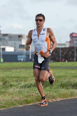 september 2: GALWAY, IRELAND - SEPTEMBER 2: Pro athlete Terenzo Bozzone (14), 2nd place, competing at the Course � Run, during 2nd Edition of the Ironman 70.3 Galway 2012 Triathlon, on September 2, 2012 in Galway, Ireland.