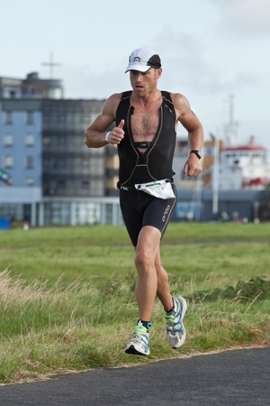 september 2: GALWAY, IRELAND - SEPTEMBER 2: Athlete Paul Holdaway (488) competing at the Course � Run, during 2nd Edition of the Ironman 70.3 Galway 2012 Triathlon, on September 2, 2012 in Galway, Ireland.