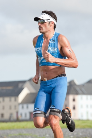 GALWAY, IRELAND - SEPTEMBER 2: Pro athlete Mike Aigroz (1), competing at the Course � Run, during 2nd Edition of the annual Ironman 70.3 Galway 2012 Triathlon,on September 2, 2012 in Galway, Ireland.