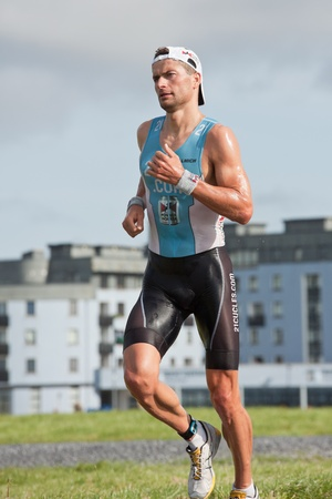 september 2: GALWAY, IRELAND - SEPTEMBER 2: Pro athlete Georg Potrebitsch (3) competing at the Course � Run, during 2nd Edition of the Ironman 70.3 Galway 2012 Triathlon, on September 2, 2012 in Galway, Ireland.