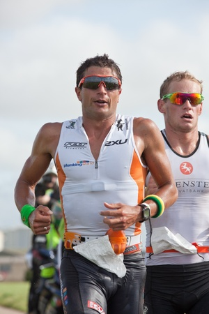 september 2: GALWAY, IRELAND - SEPTEMBER 2: Pro athletes Terenzo Bozzone (14), 2nd place)  and  Jan Van Berkel (7), Winner, competing at the Course � Run during 2nd Edition of the annual Ironman 70.3 Galway 2012 Triathlon,on September 2, 2012 in Galway, Ireland. Editorial