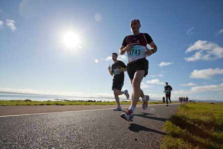 breen: GALWAY, IRELAND - OCTOBER 6: Mark Breen (1742) and other athletes compete during annual Galway Bay Half Marathon and 10K, on October 6, 2012 in Galway, Ireland.