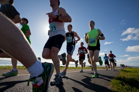 GALWAY, IRELAND - OCTOBER 6: Unidentified athletes compete during annual Galway Bay Half Marathon and 10K, on October 6, 2012 in Galway, Ireland. Editorial
