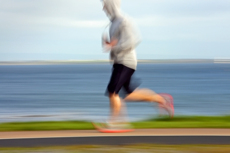 runner compete in the race at the ocean coast, blurred motion photo