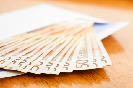 50 euro: 50 euro Banknotes stacked in the envelope, close-up, shallow DOF Stock Photo