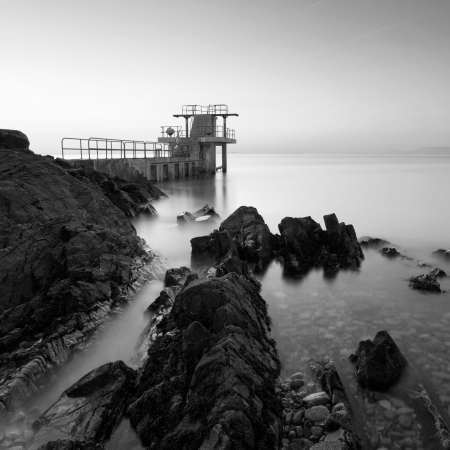 blackrock: Before the Sunrise at Blackrock diving board  Salthill, Galway, BW Stock Photo