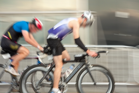 Athlets on the bicycles competing in the race, blurred motion Stock Photo