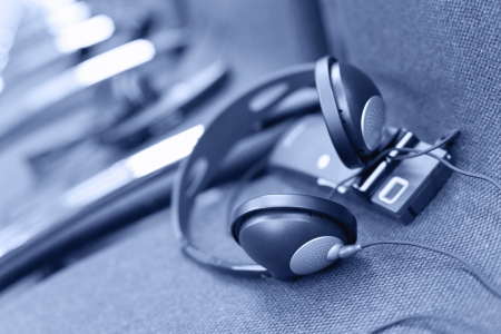 wireless multi language headphones set on the chairs in conference room. Monochromatic Stock Photo