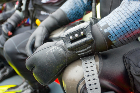 wetsuit: Scuba Divers in the boat, equipment detail . Shallow DOF