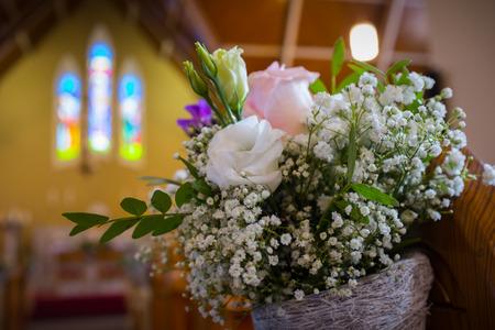 catholic wedding: Close up of Wedding flowers set up in catholic church.
